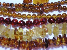 A collection of Beads and Chunks of Amber of varied colors