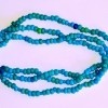 3 strand necklace made entirely with Padre Trade Beads, notice the variation of colors