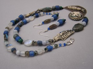 Fog woman necklace with various bohemian beads and blue Gooseberies
