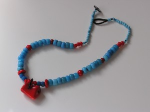 Necklace made entirely with Sky Blue Padre Trade Beads and deep red Coral beads